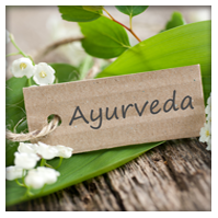 lovely flowers and greenery with ayurveda sign
