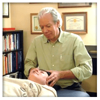 dr martin preforming a chiropractic procedure