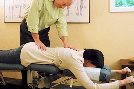 dr martin performing chiropractic on a client